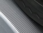 "Machined-in ""traction grooves"" provide more traction (but less heat buildup) than cosmetic diamond-knurled rolls – without requiring excessive (Hp-robbing) strap-down force."